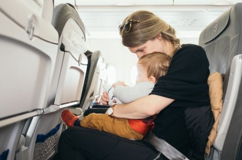 mom and baby flying in an airplane