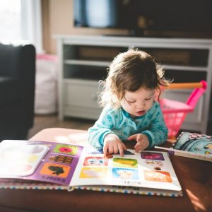 toddler playing and reading